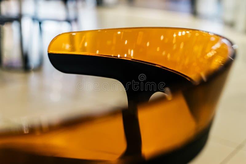 关闭透明五颜六色的椅子 免版税库存照片