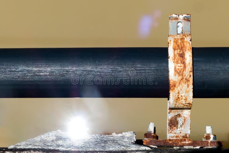 关闭黑供水管道与反射了sunligh 免版税库存照片