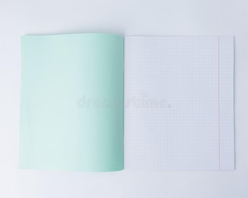 关闭 打开在笼子的学校笔记本 与拷贝空间的照片 免版税库存照片