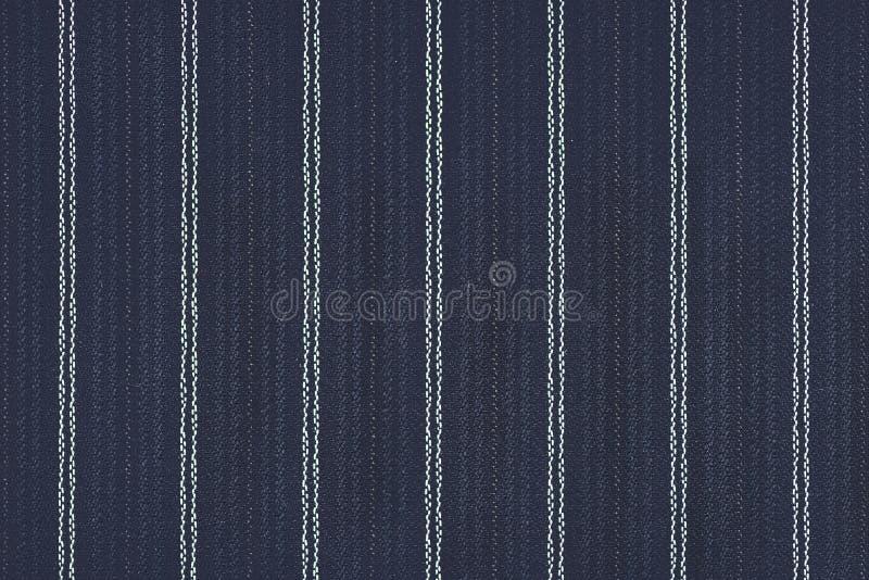 关闭细条纹布料的织品纹理背景 图库摄影