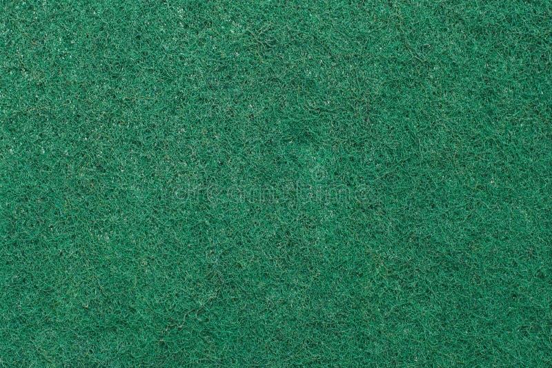 关闭绿色洗刷的海绵 库存照片