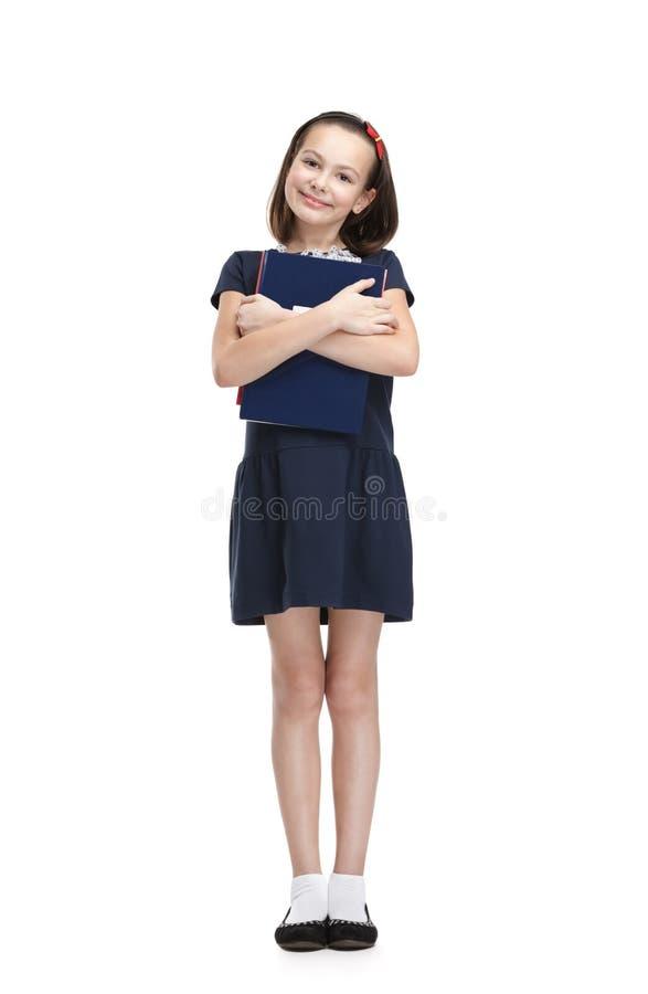 兴高采烈的女小学生 免版税图库摄影