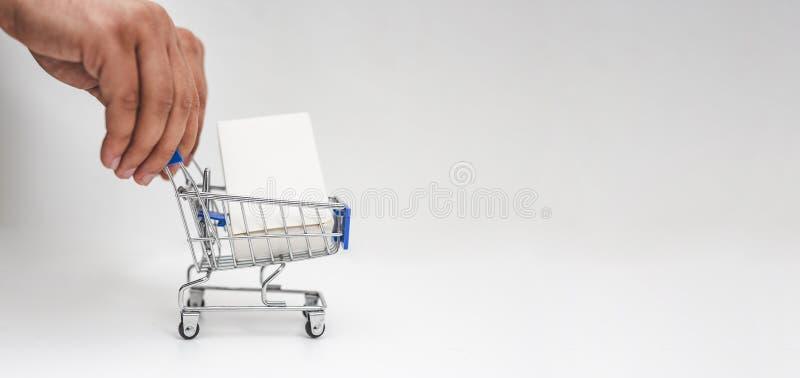 具有网上购物概念的人手推小购物车 库存图片