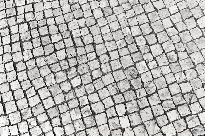 典型的葡萄牙鹅卵石路面,里斯本 免版税图库摄影
