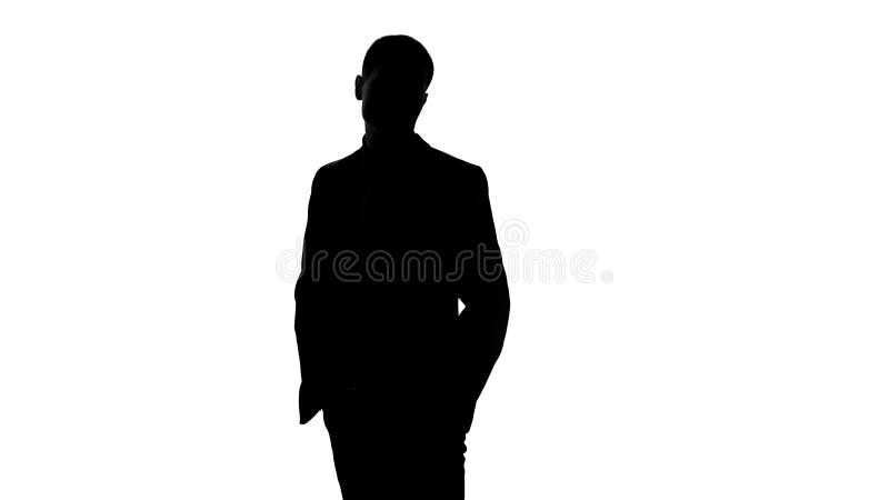 典雅的商人在衣服等待的会议,在口袋投入了手,确信 免版税库存照片