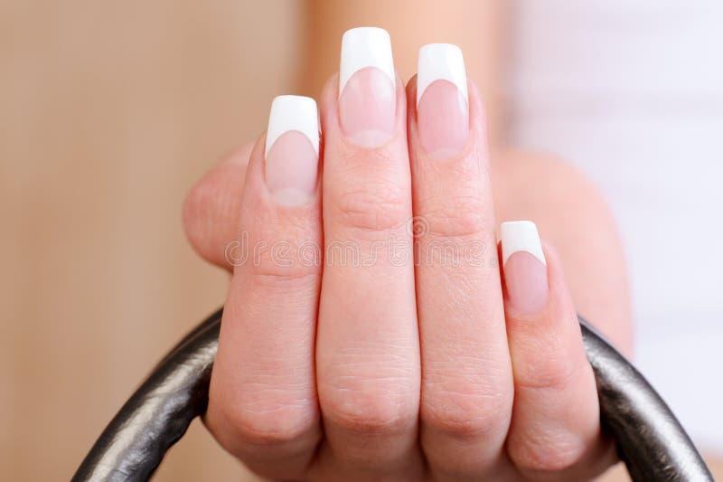 典雅的女性手指法式修剪 库存图片