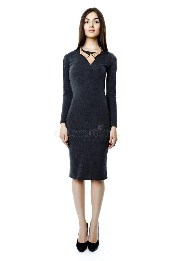 典雅的灰色礼服的妇女 库存图片