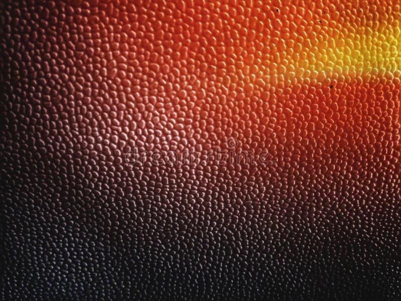 典雅的皮肤或塑料抽象黑黄色红色和桔黄色背景  库存照片