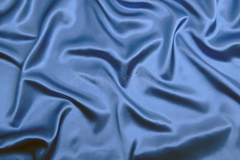 典雅的蓝色丝绸布料纹理抽象背景 图库摄影