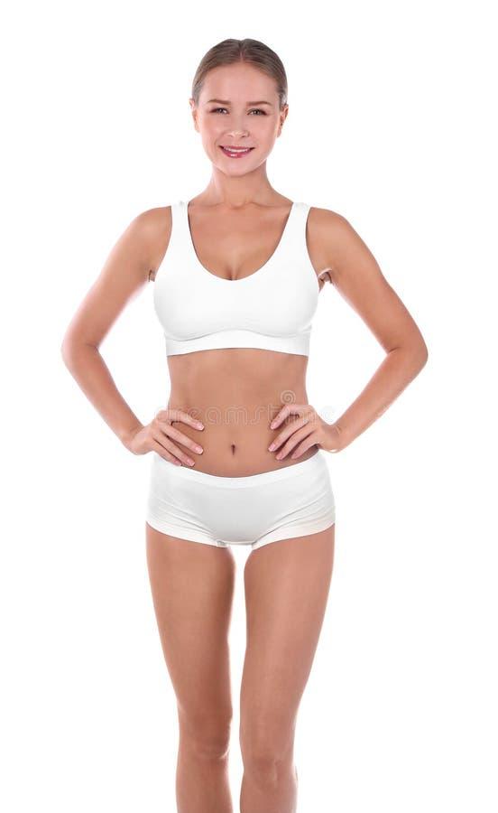 内衣的亭亭玉立的妇女在白色背景 免版税图库摄影