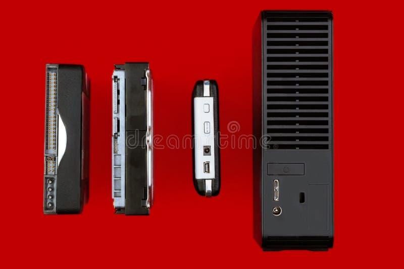 内部硬盘和外在hdd在红色背景 免版税库存图片