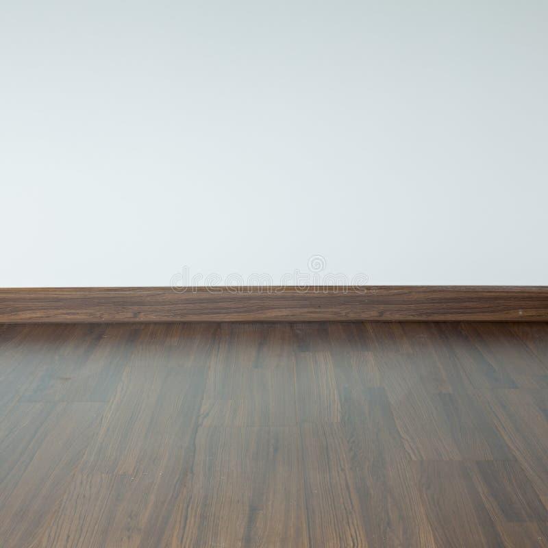 内部空的室,棕色木头层压制品地板 免版税库存照片