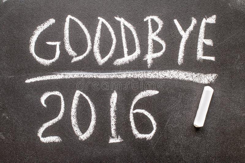再见2016在黑板写的文本 库存照片