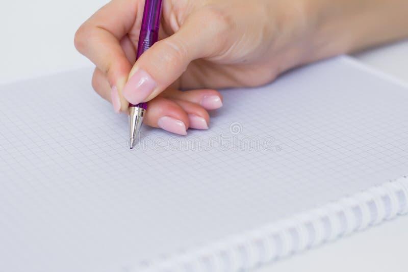 写下笔记在纸笔记薄 库存照片