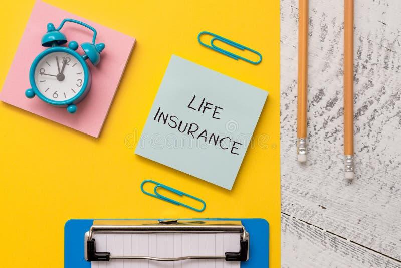 写显示生命保险的笔记 企业照片陈列的付款死亡抚恤金或伤害埋葬或医疗 库存图片