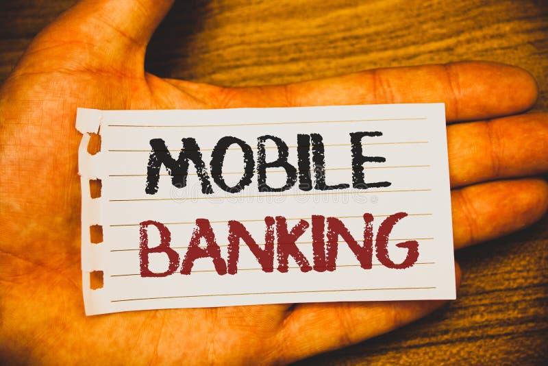 写流动银行业务的手写文本 意味网上现款支付和交易真正银行的概念发短信给两个词writte 免版税库存照片