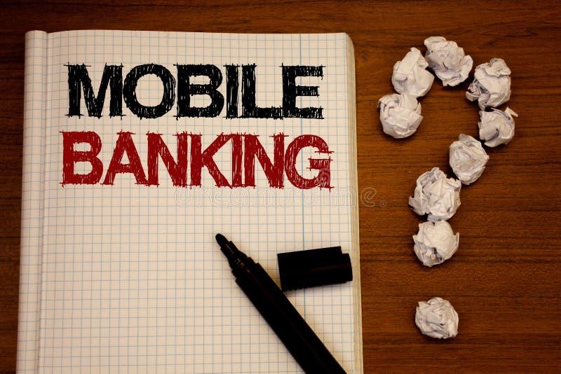 写流动银行业务的手写文本 意味网上现款支付和交易真正银行的概念发短信给笔记本黑m 图库摄影