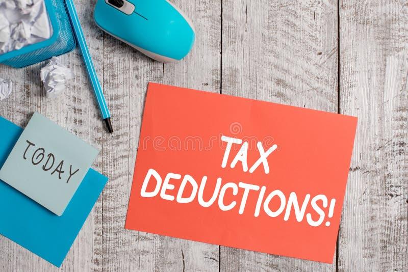 写税收减免的手写文本 意味能被弄皱的被收税费用的减少收入的概念 免版税库存图片