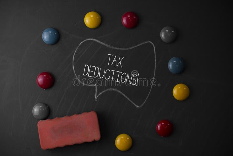 写税收减免的手写文本 意味能被收税费用在周围的减少收入的概念 免版税图库摄影