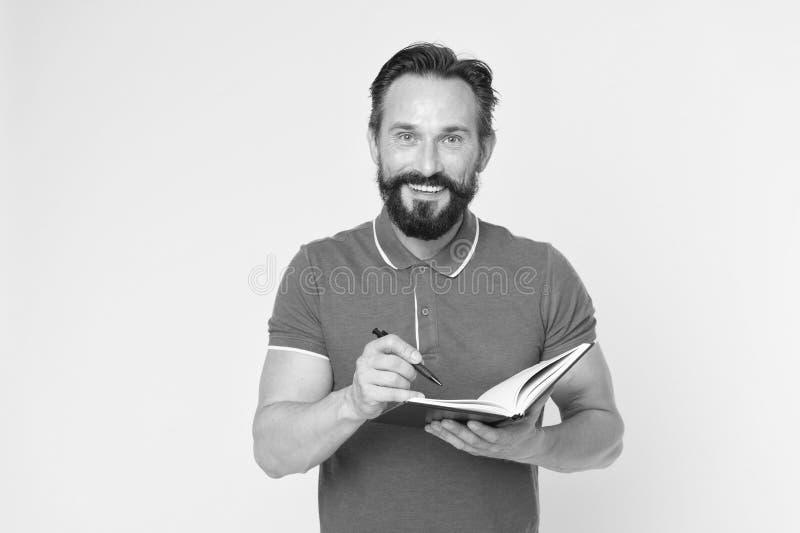 写笔记的人成熟有胡子的人给笔记薄 检查什么做 每日日程表 开发的习性和设定 库存图片