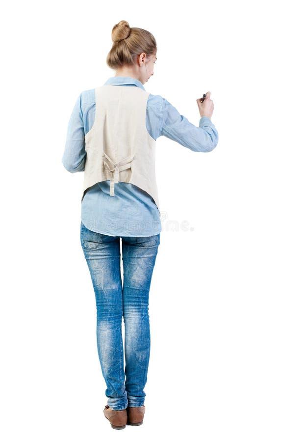写美丽的妇女后面看法  库存照片