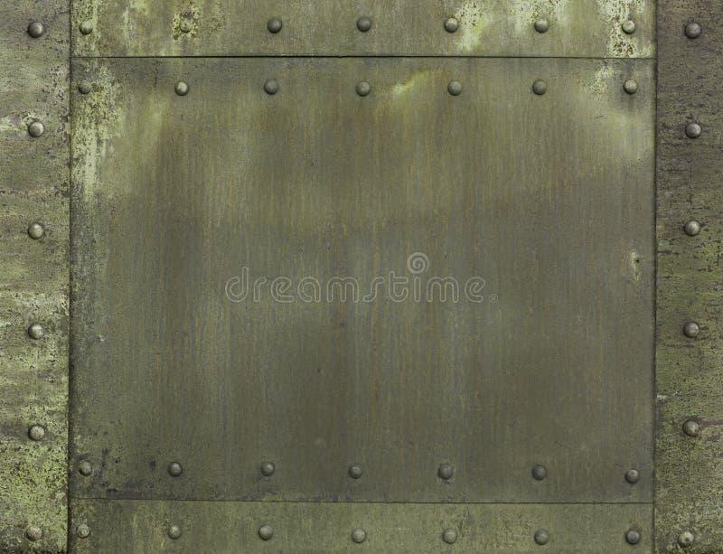 军事卡其色的被绘的金属装甲背景 库存图片