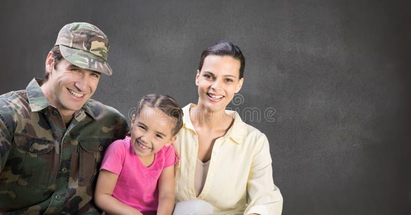 军事家庭有灰色背景 库存图片