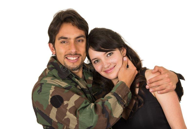 年轻军事战士回来遇见他的妻子 免版税库存照片