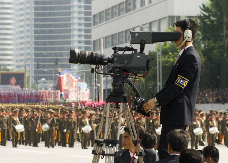 军事游行的北朝鲜摄影师 免版税库存照片
