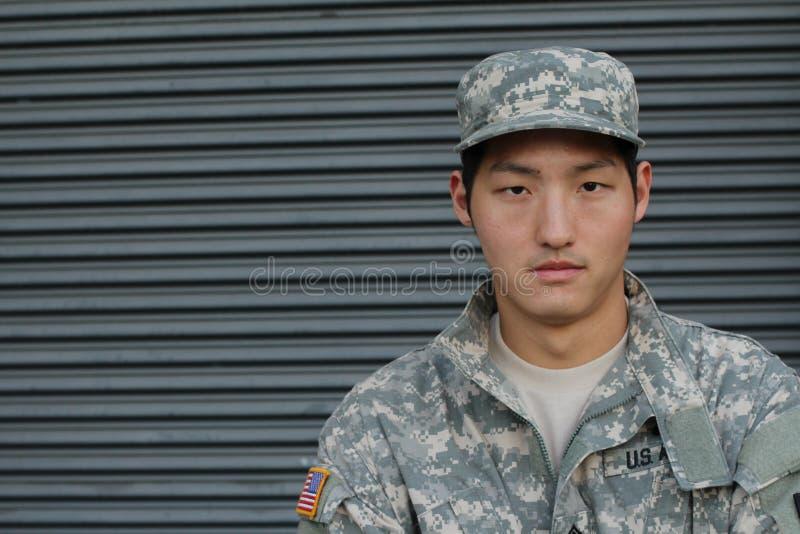 军事年轻亚裔人 工作室纵向 图库摄影