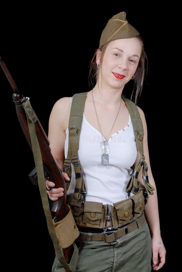 军服摆在的性感的妇女 库存照片