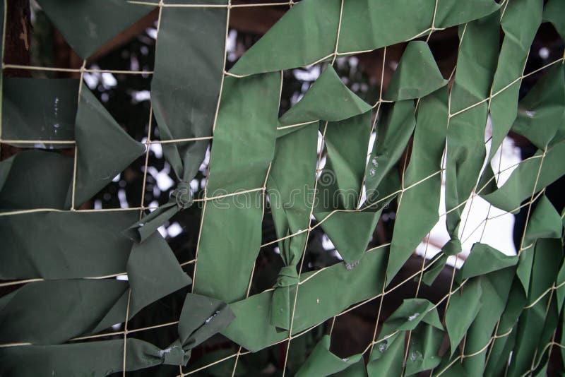 军队军事伪装绿色掩没的净背景 库存照片