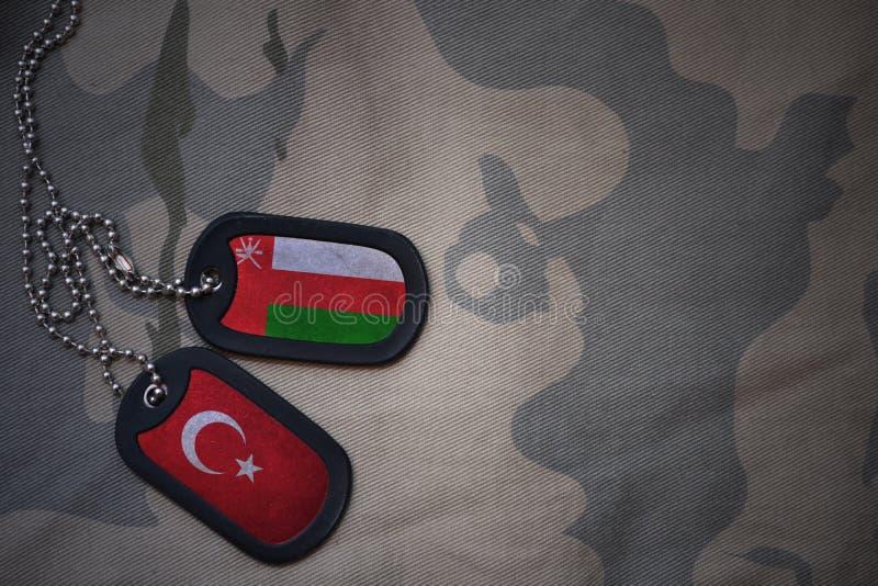 军队空白、卡箍标记与阿曼的旗子和火鸡 库存照片