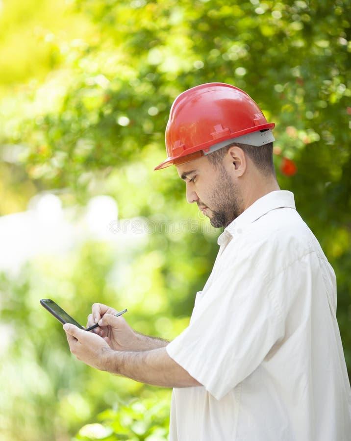 农业工程师在工作 免版税库存图片