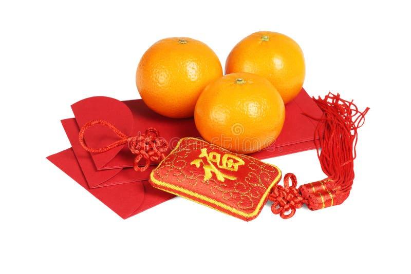 农历新年装饰品和橘子-意味时运的汉字 图库摄影