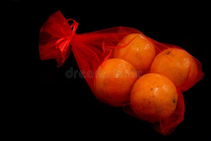 农历新年在黑背景的橘子 库存照片