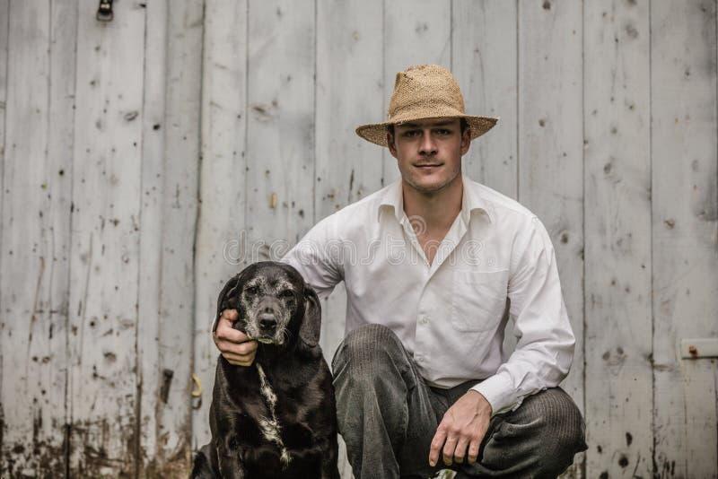 农夫和他的最好的朋友 免版税库存照片