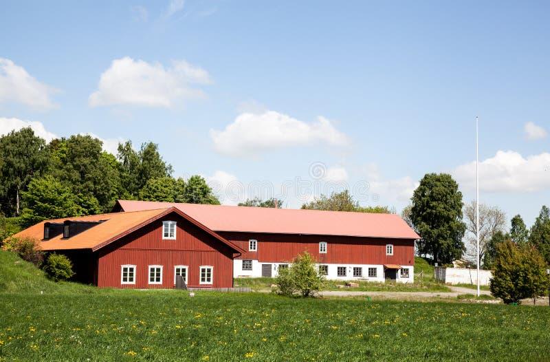 农夫房子。议院和环境在瑞典 免版税库存照片