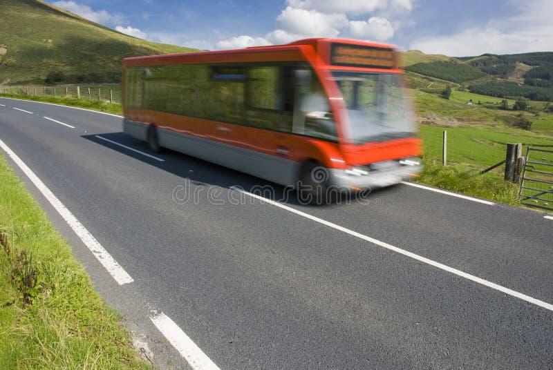 农村公共汽车红色的路 库存照片