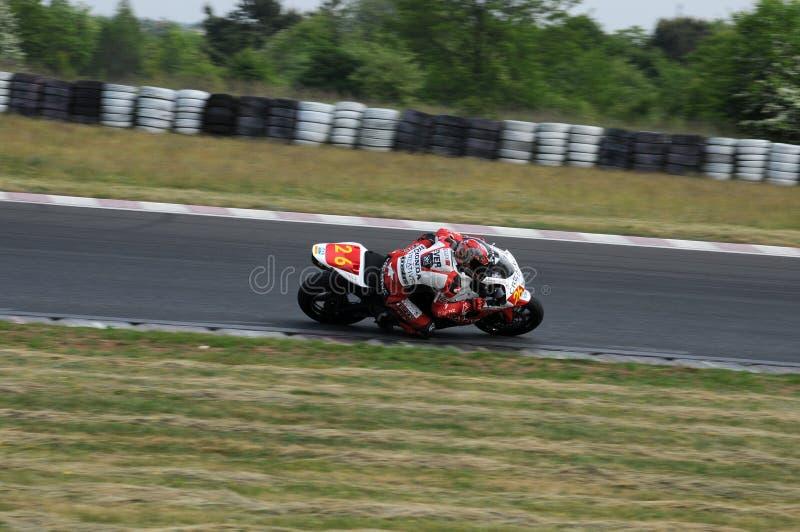 冠军摩托车赛跑 免版税库存照片