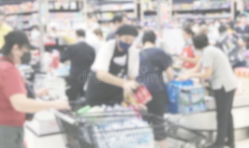 冠状病毒引起的超市购物者背景模糊抽象 库存照片