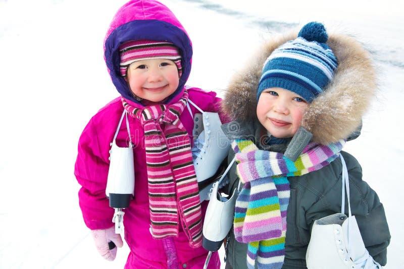 冬天的小溜冰者 库存图片