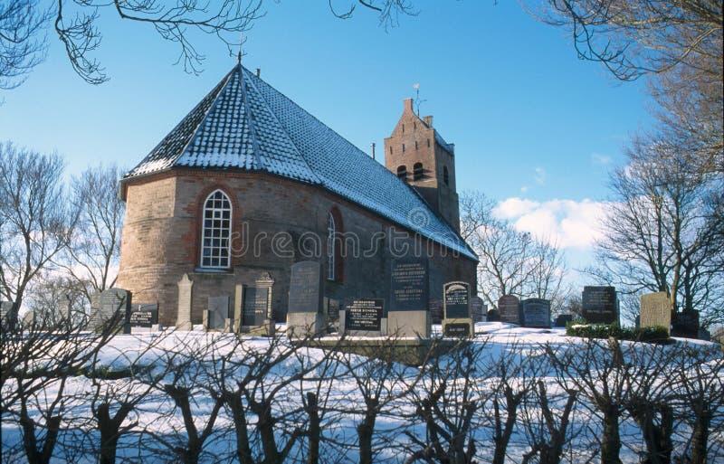 冬天风景的经典荷兰教会 免版税库存图片