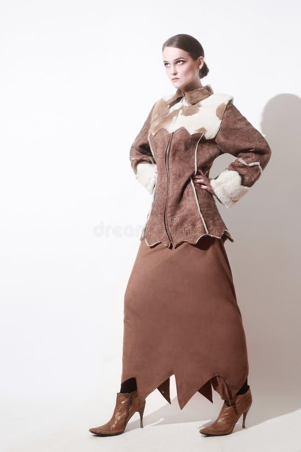 冬天给时尚妇女紧身连衫外套穿衣 库存照片