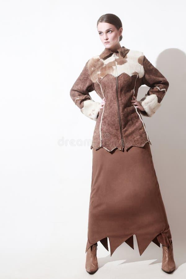 冬天给时尚妇女紧身连衫外套穿衣 图库摄影
