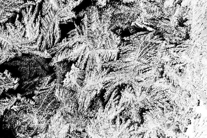 冰和雪花的纹理 在黑玻璃的冻水 背景蓝色雪花白色冬天 冷淡的自然雪花样式 免版税库存图片