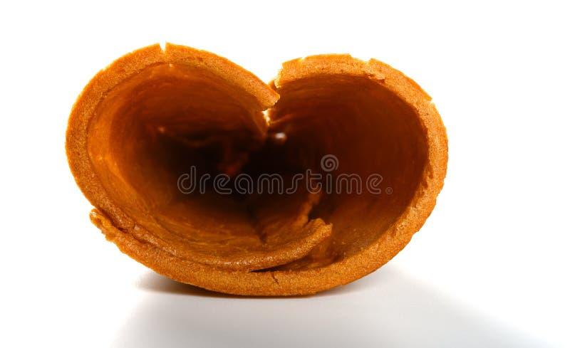 冰淇淋的壳圆锥形象在白色背景的心脏 库存照片