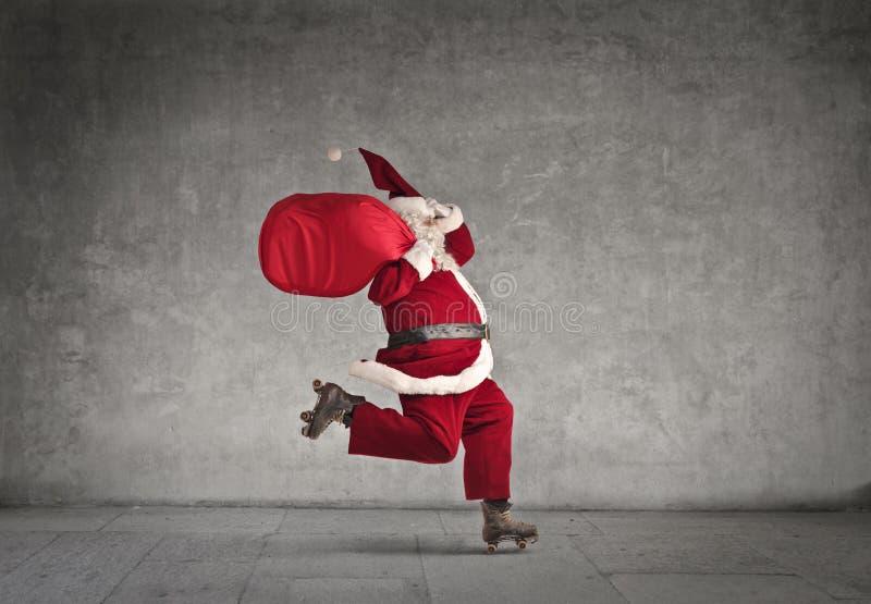 滑冰的圣诞老人 免版税图库摄影