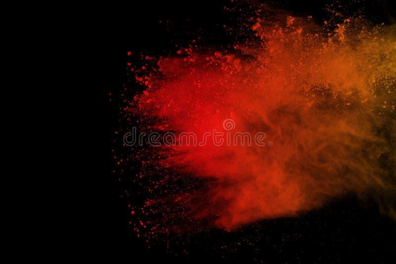 冷冻在黑背景隔绝的色的粉末爆炸的行动 splatted的多色尘土摘要 库存图片