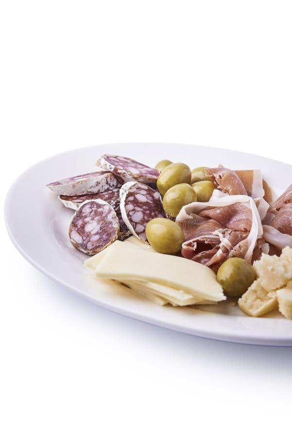 冷盘和乳酪在板材 免版税库存照片